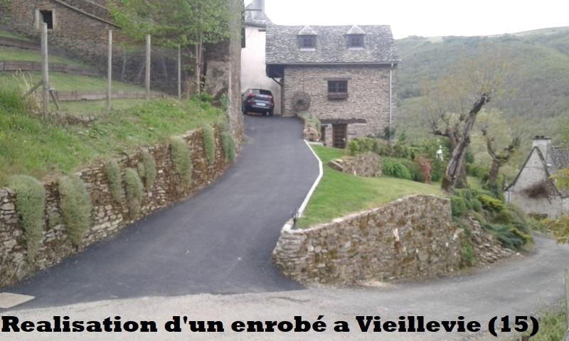 Réalisation d'un enrobé a Vieillevie (15)